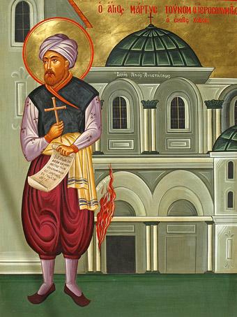 Sfântul Mucenic Tunom şi în spate coloana care arde, în icoana care se află în Mănăstirea Megali Panaghia din Ierusalim.